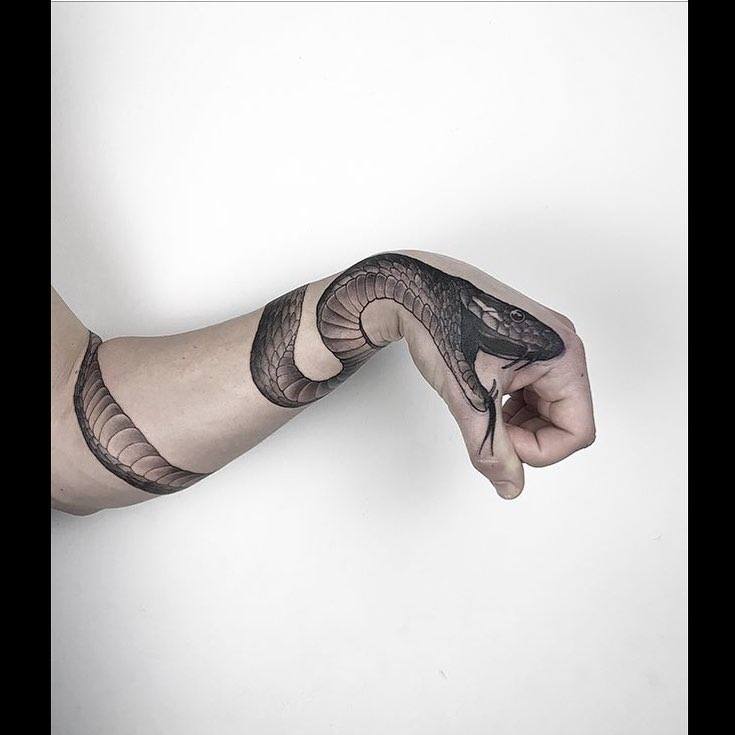 Snake tattoo on the arm and the hand