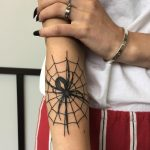 Spider in the web tattoo