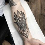 Stylized deer head tattoo