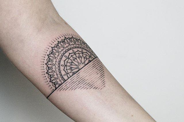 Stylized sun tattoo