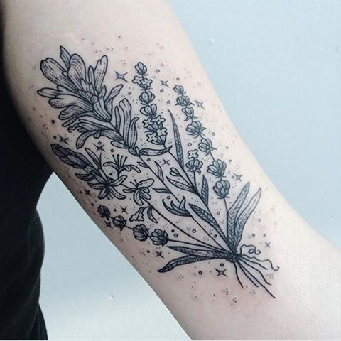 Subtle black wildflower tattoo