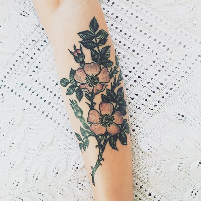 Subtle flowers tattoo design
