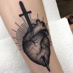 Sword stabbed heart tattoo