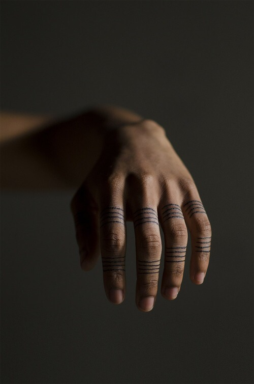 Thin black stripes tattoos on fingers