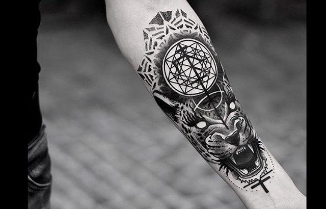 Tigger head and sacred geometry tattoo
