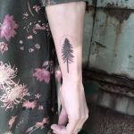 Tiny fir tree tattoo on the right forearm