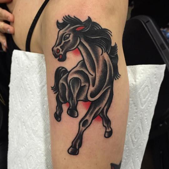 Traditional black horse tattoo