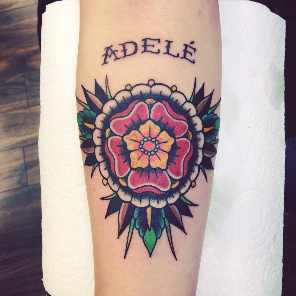 Traditional flower tattoo with a name adele