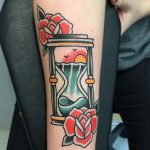 Traditional hourglass tattoo on the arm