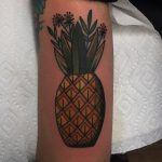 Traditional pineapple tattoo on the arm