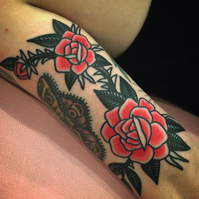 Traditional red roses tattoo