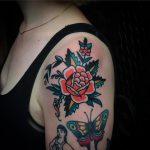 Traditional rose tattoo on the left shoulder