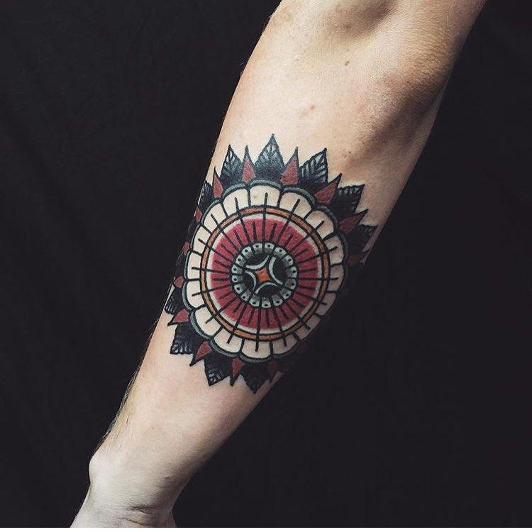 Traditional style mandala forearm tattoo