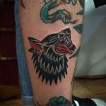 Traditional wolf tattoo on the leg