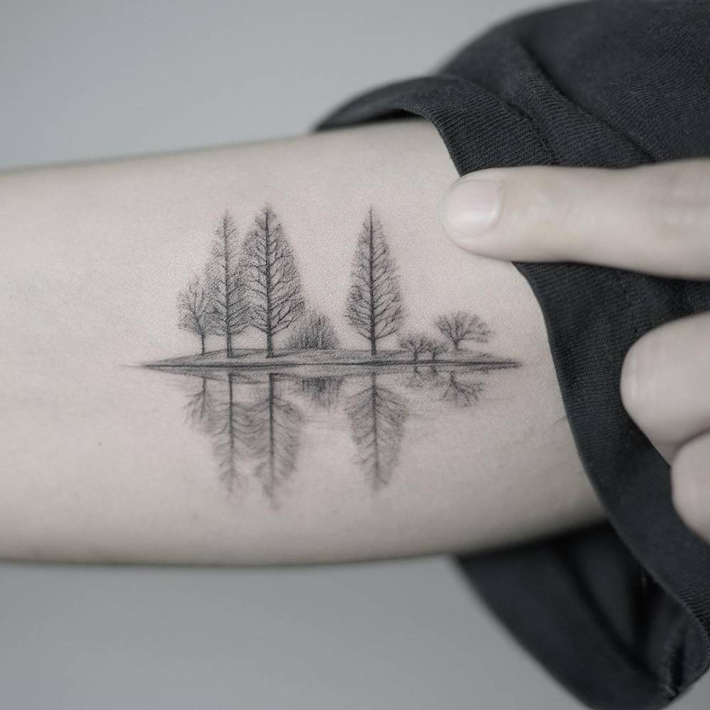 Trees reflection in the water tattoo