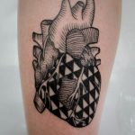 Triangular pattern heart tattoo