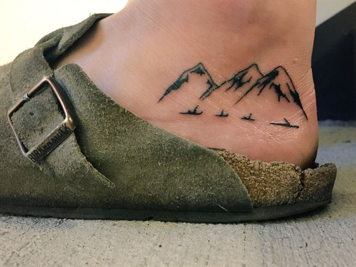 Triple mountain tattoo on the ankle