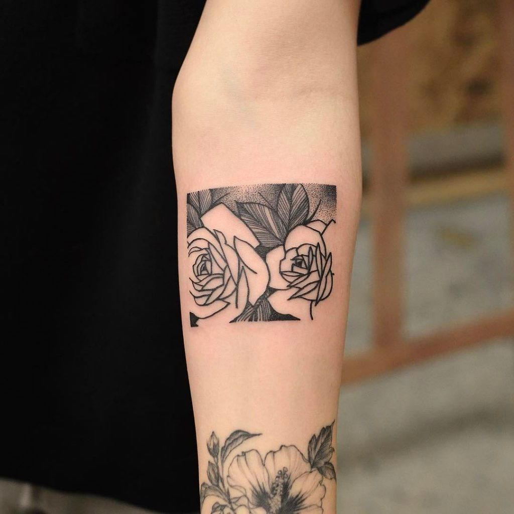 Two roses tattoo in the rectangle
