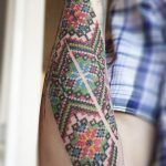 Ukrainian pattern vyshyvka tattoo on the forearm