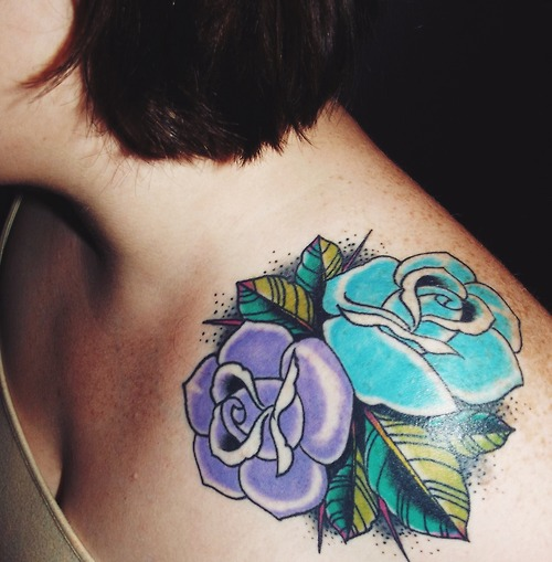 Violet and teal flowers tattoo