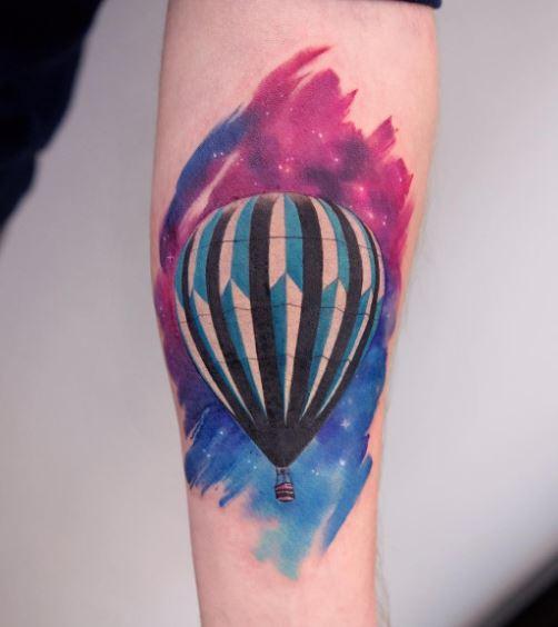 Watercolor air balloon tattoo