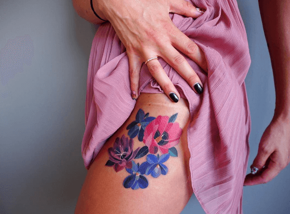 Watercolor blue and pink flower tattoo