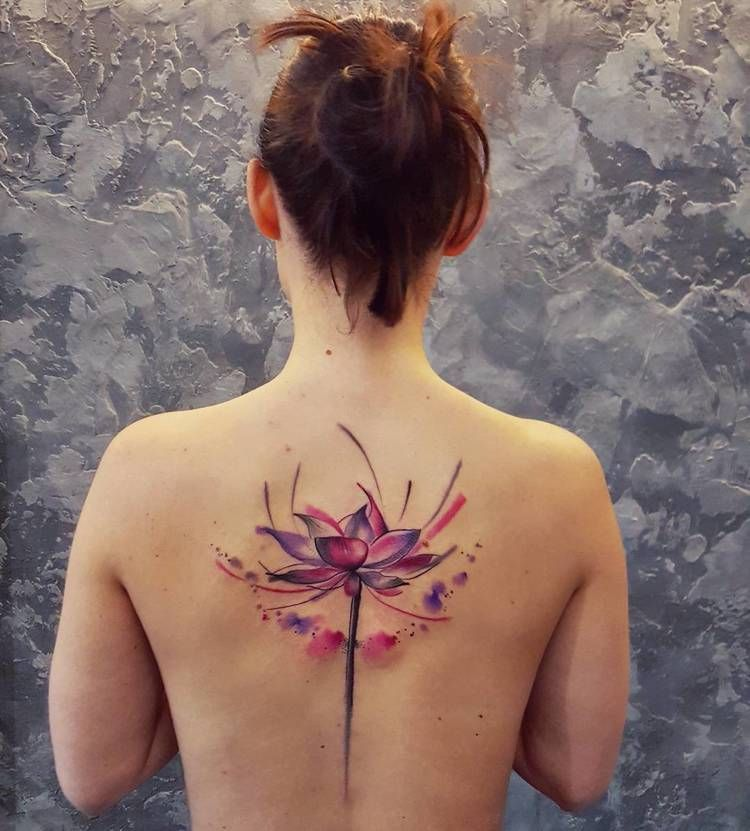 Watercolor flower tattoo on the back