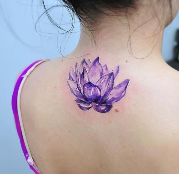 Watercolor lotus flower tattoo on the back