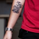 Wave and small island tattoo