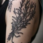 Wildflower bouquet tattoo on the arm