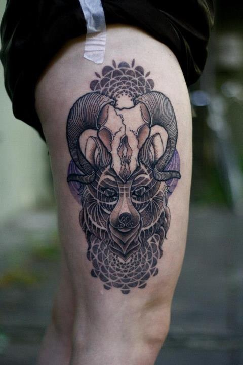 Wolf and antler tattoo on the thigh