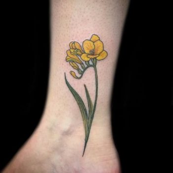 Flower tattoos discover the most beautiful flower tattoo gallery in yellow flower on the ankle mightylinksfo
