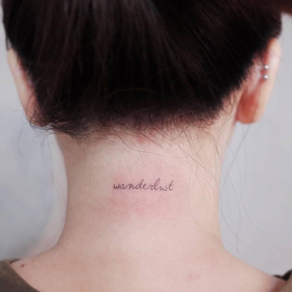 Wanderlust tattoo on the neck