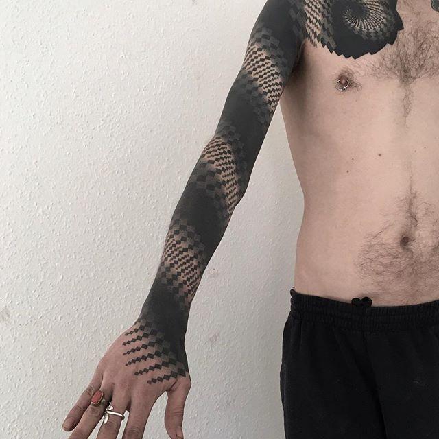 Abstract geometric pattern full sleeve tattoo