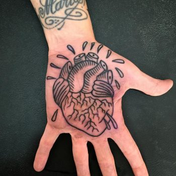 Anatomical heart tattoo on the palm