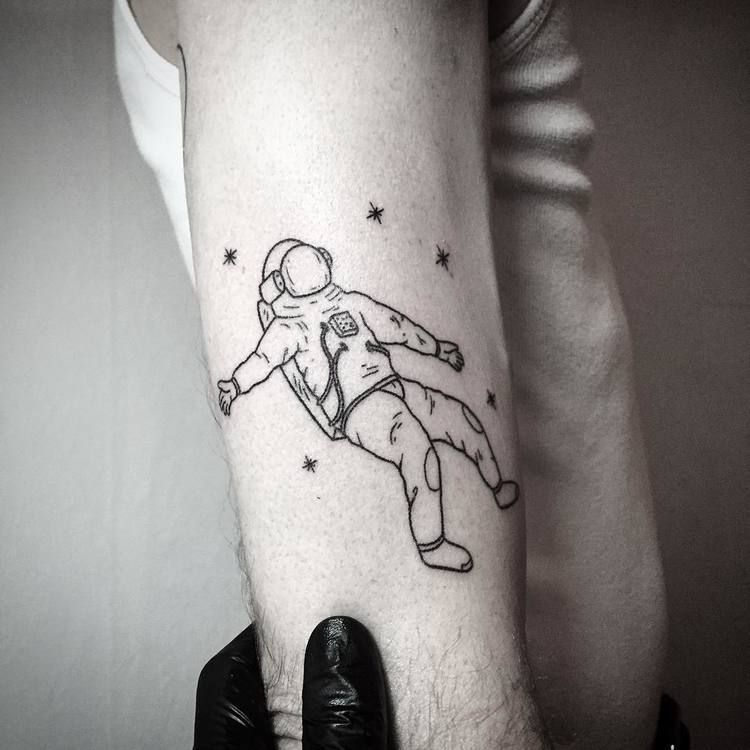 Astronaut tattoo on the arm