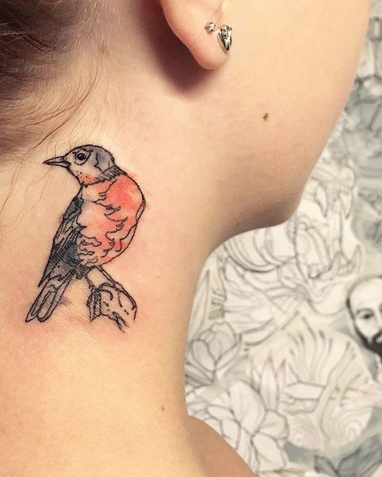 Bird tattoo on the neck
