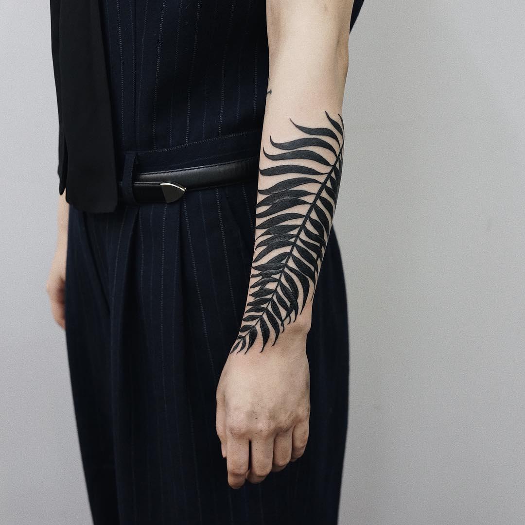 Black awesome fern leaf tattoo