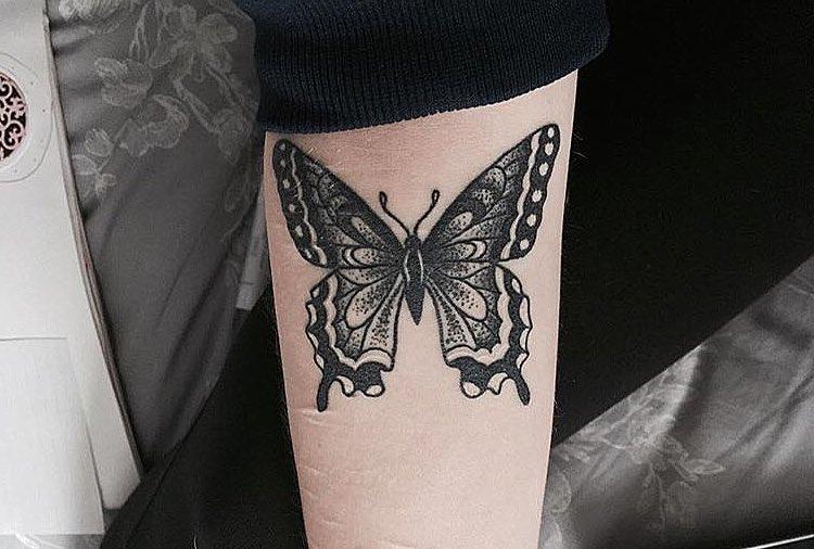Black beautiful butterfly tattoo