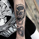 Black devil and heart tattoo