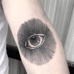 Black eye tattoo on the forearm