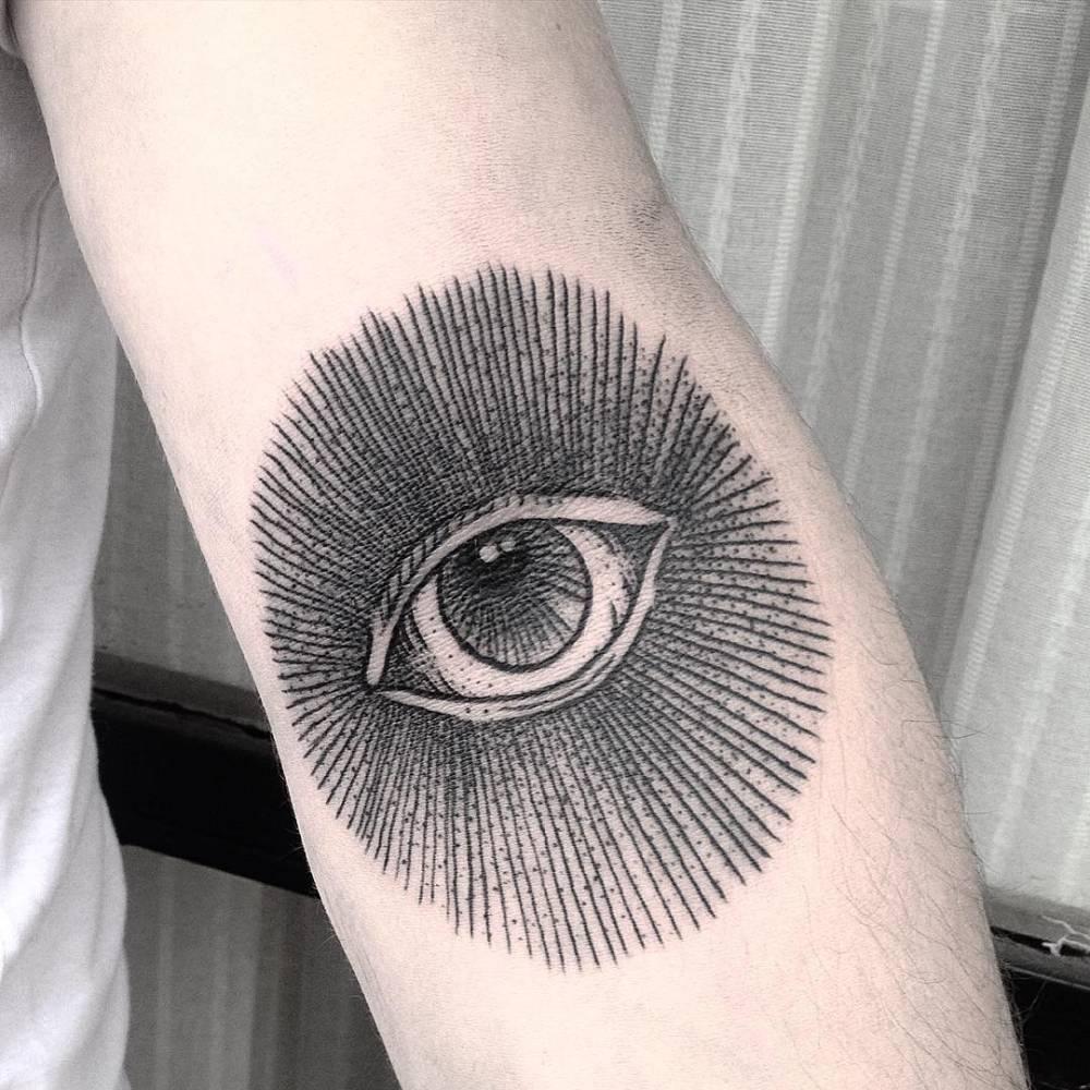 Black eye tattoo on the forearm