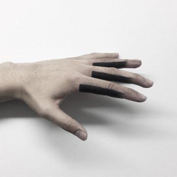 Black finger tattoos