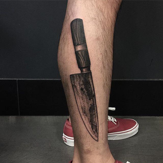 Black knife tattoo