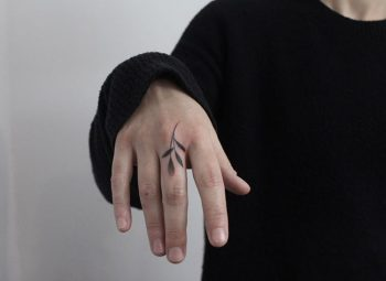 Black leaf tattoo