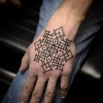 Black ornamental pattern hand tattoo