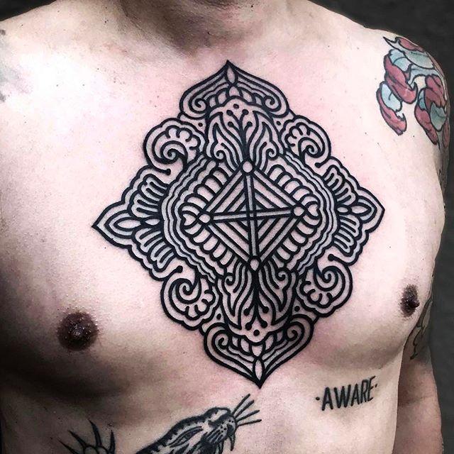 Black pattern chest tattoo