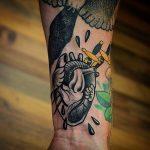 Black pierced heart tattoo