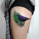 Blackbird on a palm leaf tattoo