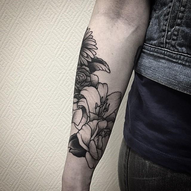 Blackwork floral forearm tattoo